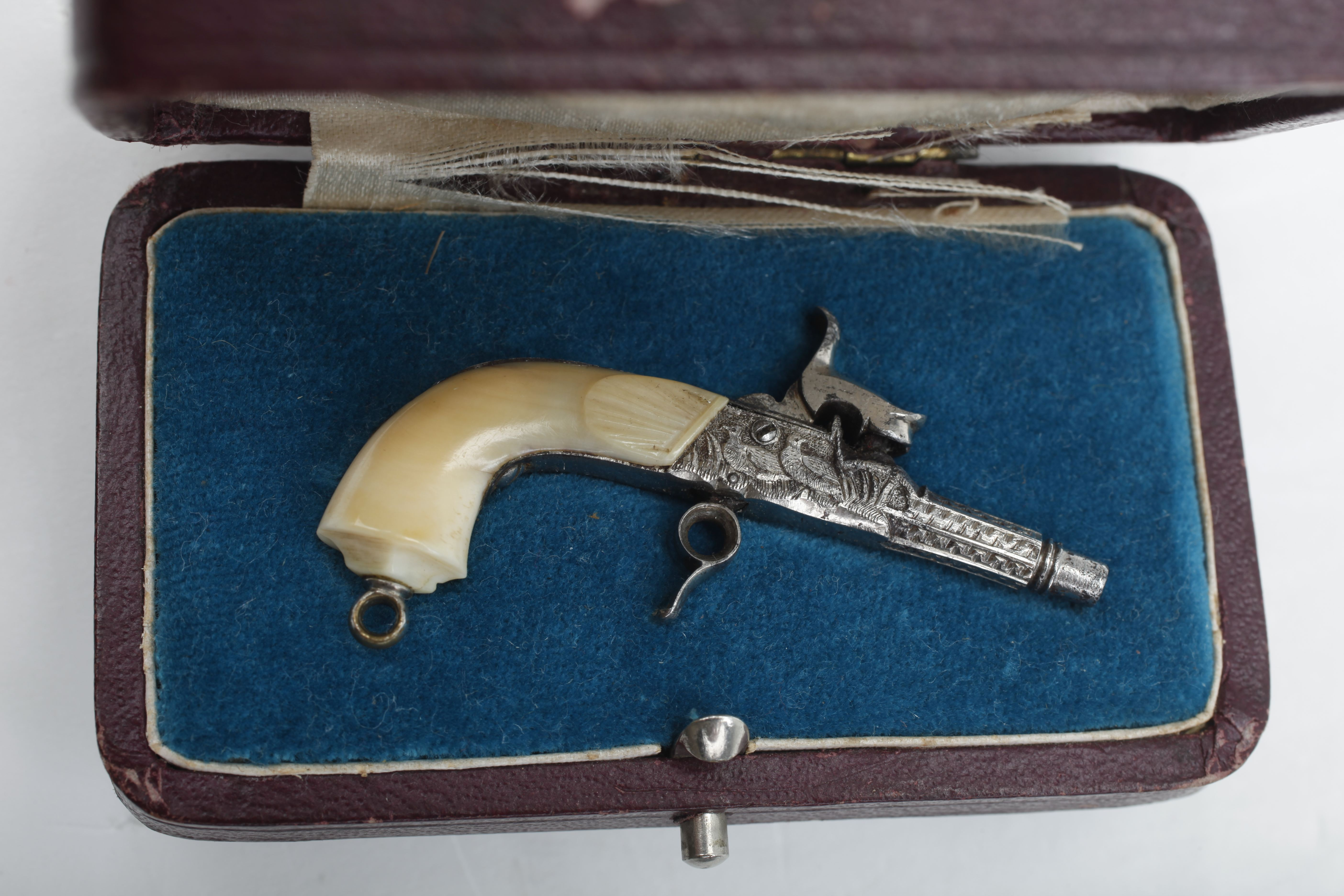 Minature Ivory Stocked Percussion Pistol